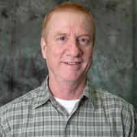 head shot of Bob Blum against a grey background