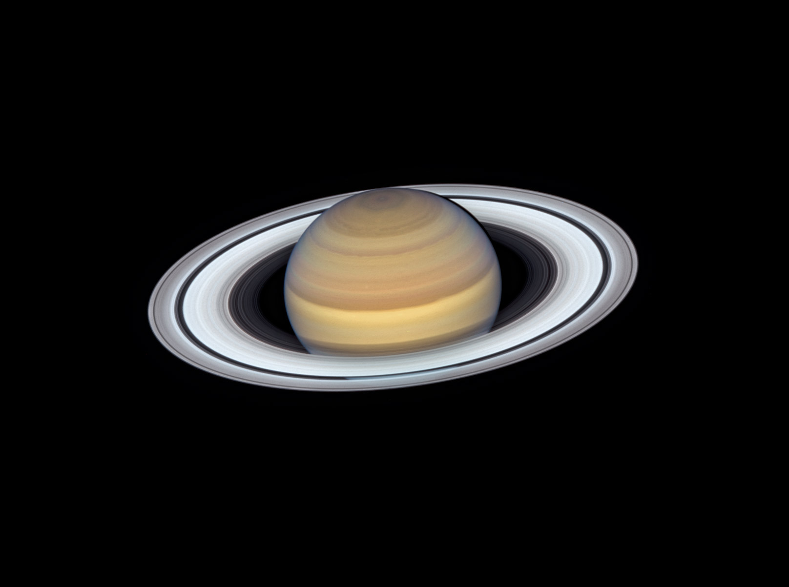 saturn and its rings on a back background