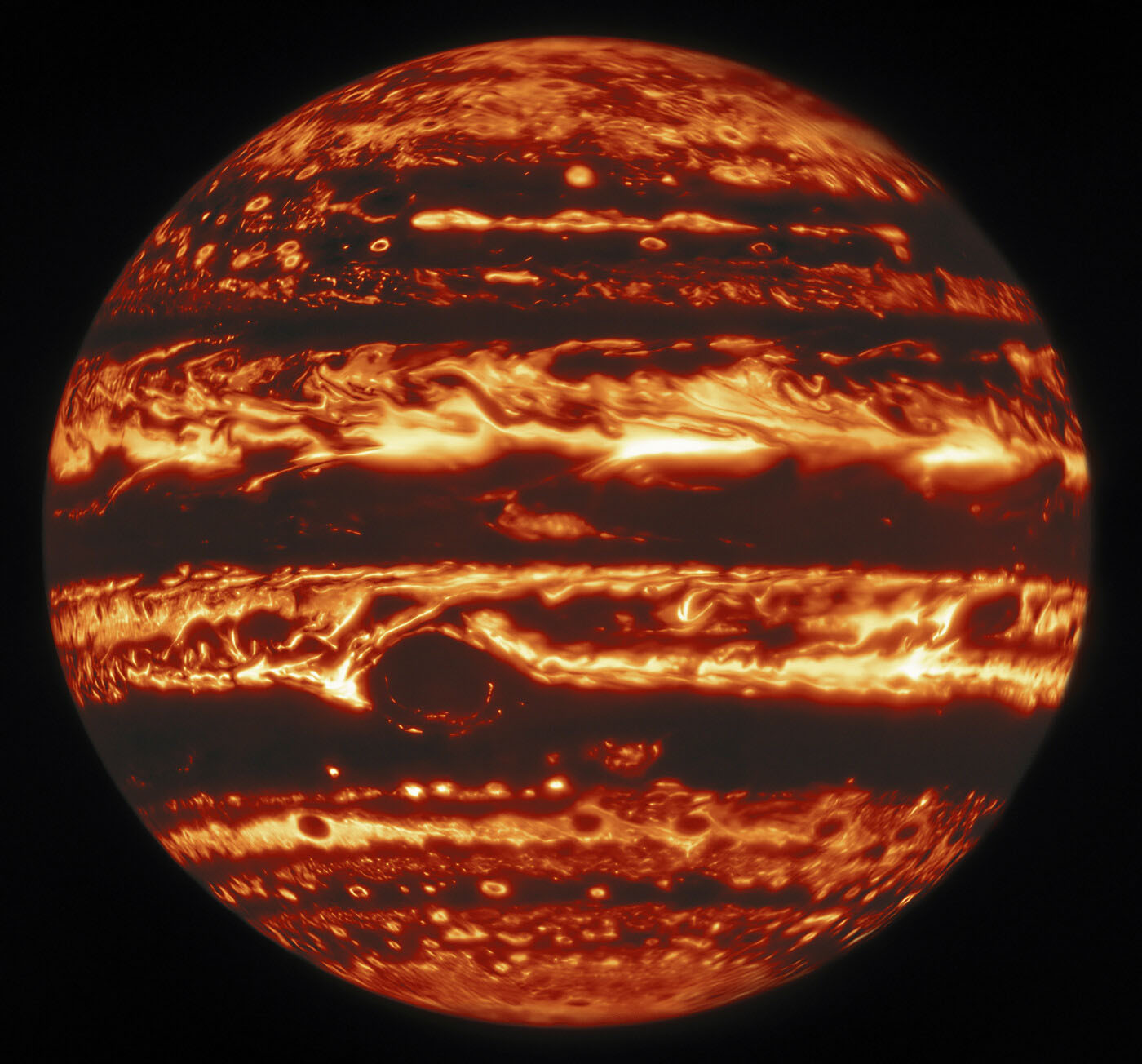 This infrared view of Jupiter was created from data captured on 11 January 2017 with the Near-InfraRed Imager (NIRI) instrument at Gemini North in Hawaiʻi, the northern member of the international Gemini Observatory, a Program of NSF's NOIRLab. It is actually a mosaic of individual frames that were combined to produce a global portrait of the planet. In the image warmer areas appear bright, including four large hot spots that appear in a row just north of the equator. South of the equator, the oval-shaped and cloud-covered Great Red Spot appears dark.