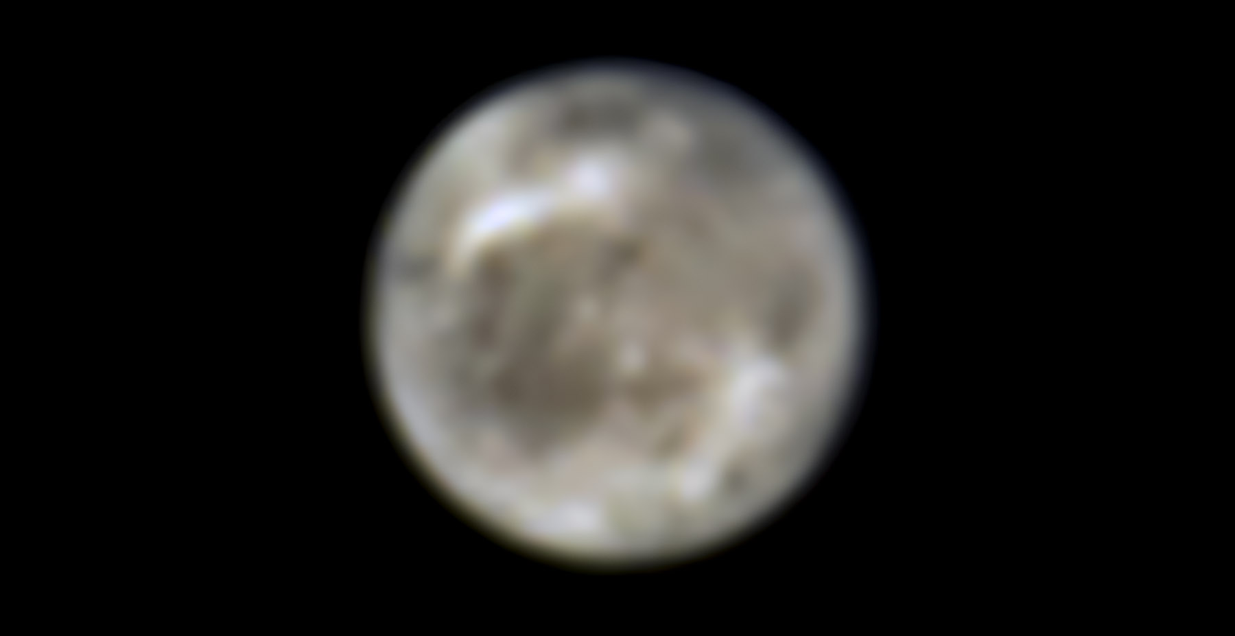 This image presents Jupiter's moon Ganymede as seen by the NASA/ESA Hubble Space Telescope in 1996. Located over 600 million kilometers away, Hubble can follow changes on the moon and reveal other characteristics at ultraviolet and near-infrared wavelengths.